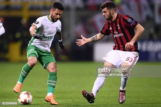 Ludogorets's midfielder Wanderson Cristaldo Farias from Brazil fights for the ball with AC Milan's forward Patrick Cutrone from Italy during the UEFA...