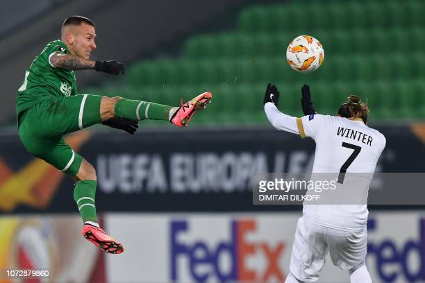 Ludogorets's Polish midfielder Jacek Goralski vies with Zurich's Swiss midfielder Adrian Winter during the UEFA Europa League Group A football match...