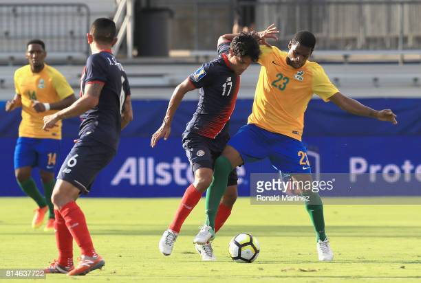 Ludovic Baal of French Guiana right dribbles the ball against Yeltsin Tejeda during the 2017 CONCACAF Gold Cup at Toyota Stadium on July 14 2017 in...