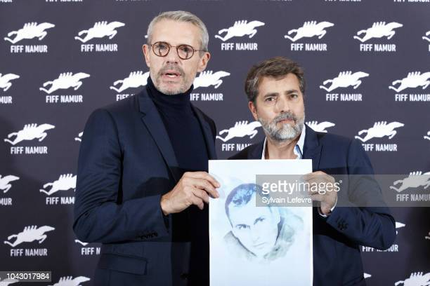 Ludovic Bernard and Lambert Wilson hold a photo of the Ukrainian filmmaker Oleg Gennadyevich Sentsov to support the international campaign for the...