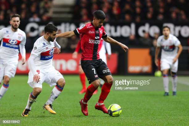 Ludovic Blas of Guingamp and Nabil Fekir of Lyon during the Ligue 1 match between EA Guingamp and Olympique Lyonnais at Stade du Roudourou on January...