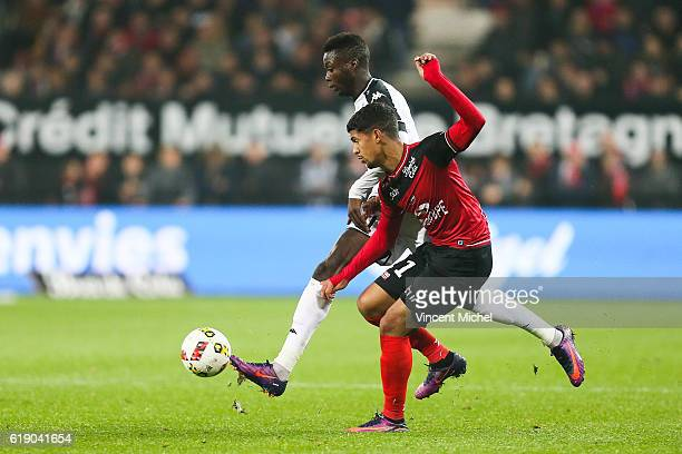 Ludovic Blas of Guingamp and Nicolas Pepe of Angers during the Ligue 1 match between Guingamp and Angers at Stade du Roudourou on October 29 2016 in...