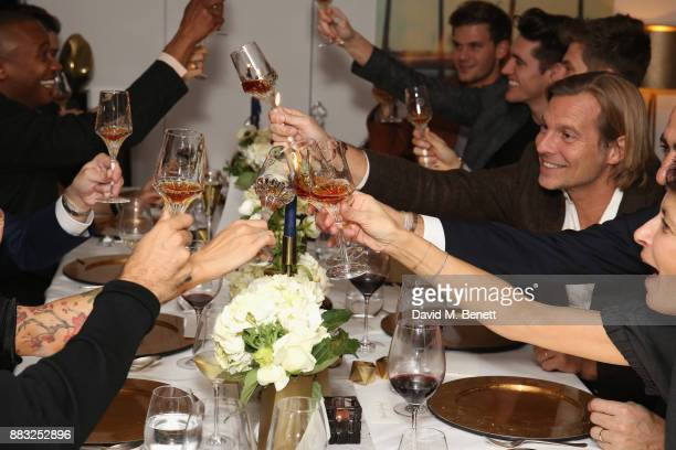 Ludovic du Plessis and guests cheers as LOUIS XIII and Dylan Jones GQ Editor in Chief cohost Intimate Dinner Celebrating the brand's '100 Years'...