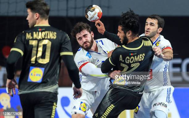 Ludovic Fabregas and Romain Lagarde of France and Andre Gomes of Portugal during the 27th IHF Men's World Champioship Group III match between...