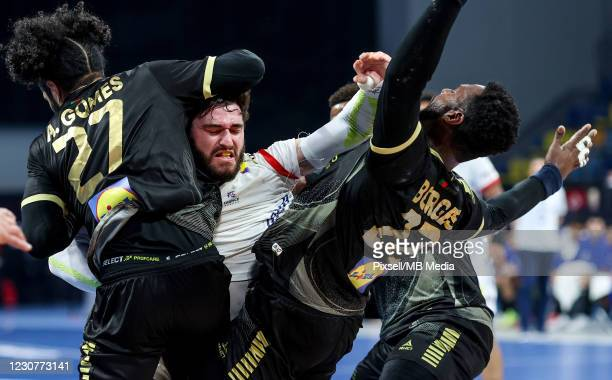 Ludovic Fabregas of France and Andre Gomes and Alexis Borges of Portugal during the 27th IHF Men's World Champioship Group III match between Portugal...