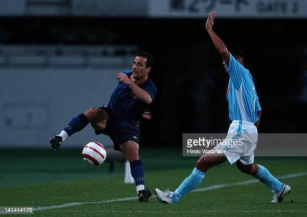 Ludovic Giuly of Barcelona and Yoshiaki Ota of Jubilo Iwata during the preseason friendly match between Jubilo Iwata and FC Barcelona at Shizuoka...