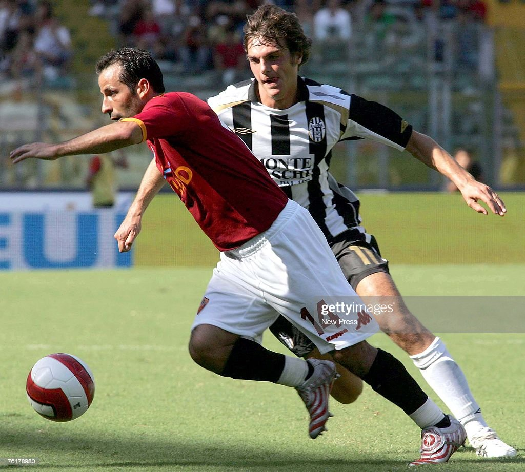 Ludovic Giuly of Roma battles for the ball with Paolo de Ceglie of Siena during a Serie A match between Roma and Siena at the Stadio Olimpico on September 02, 2007 in Rome, Italy.