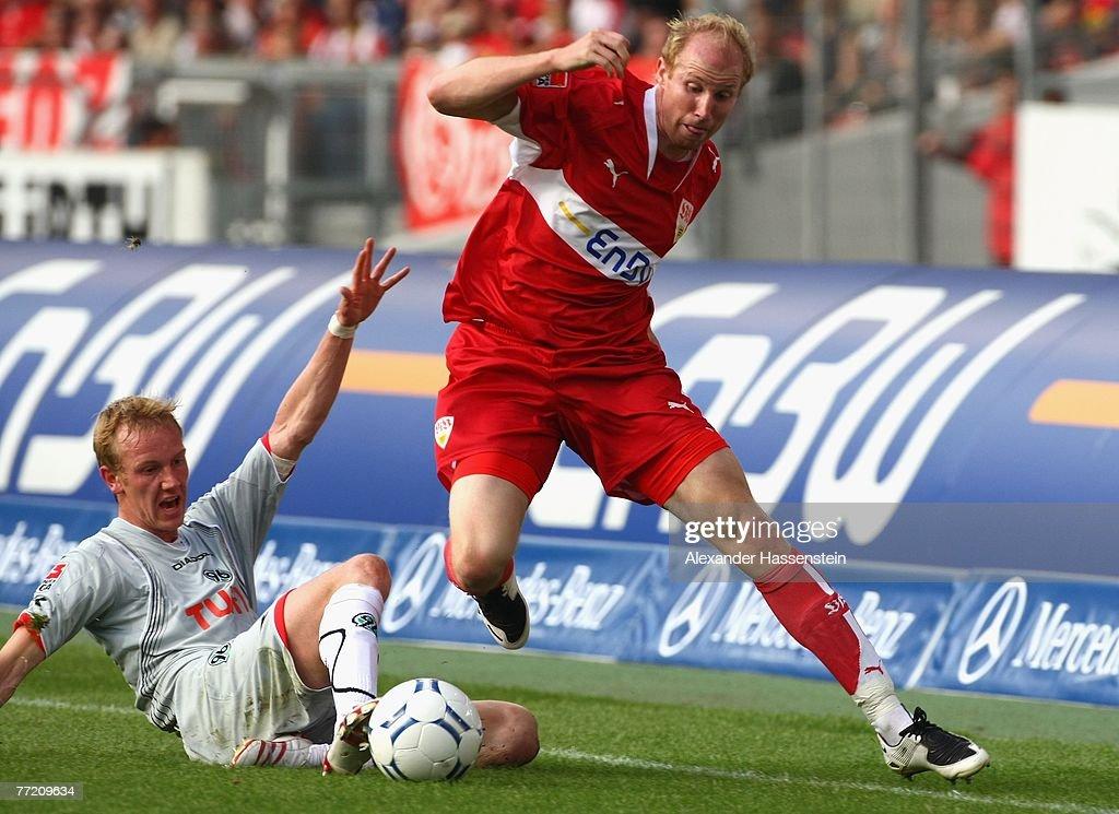 Ludovic Magnin of Stuttgart (R) battles for the ball with Jan Rosenthal of Hannover during the Bundesliga match between VfB Stuttgart and Hannover 96 at the Gottlieb-Daimler-Stadium on October 06, 2007 in Stuttgart, Germany.