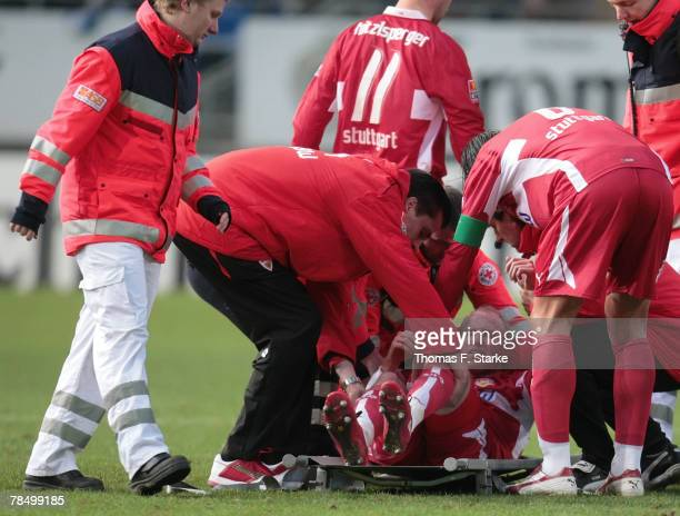 Ludovic Magnin of Stuttgart receives medical treatment during the Bundesliga match between Arminia Bielefeld and VfB Stuttgart at the Schueco Arena...