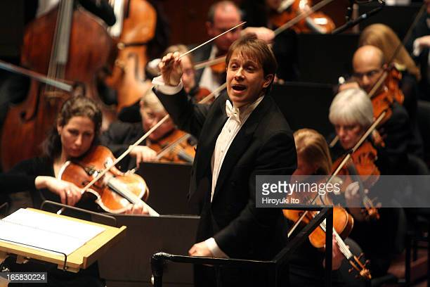 """Ludovic Morlot conducting the New York Philharmonic in Elliott Carter's """"Aleegro scorrevole"""" at Avery Fisher Hall on Thursday night, March 2, 2006."""