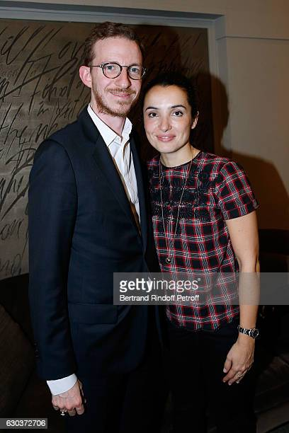 Ludovic Watine and actress Isabelle Vitari pose Backstage after the triumph of the Dany De Boon Des HautsDeFrance Show at L'Olympia on December 2...