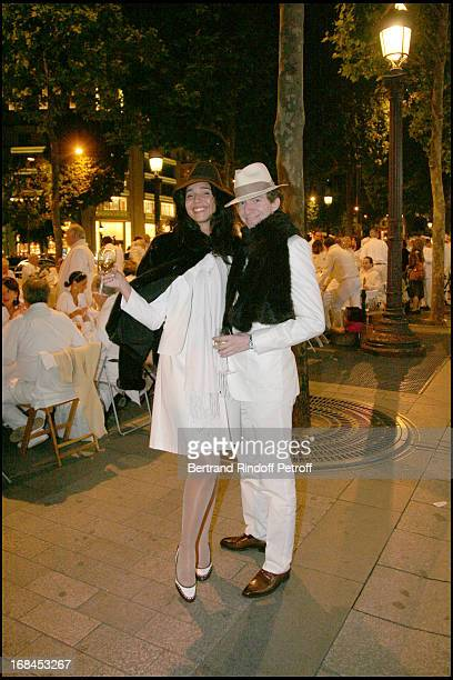 Ludovic Watine Arnault and his fiancee at The Nuit Blanche Event On The Champs Elysees Avenue In Paris