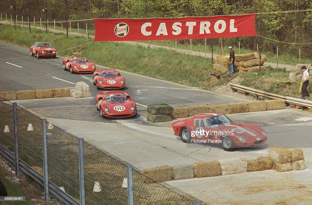 Ferrari Dino 206 S and Monza 10.1 km Ludovico-scarfiotti-john-surtees-nino-vaccarella-and-lorenzo-bandini-picture-id555549461