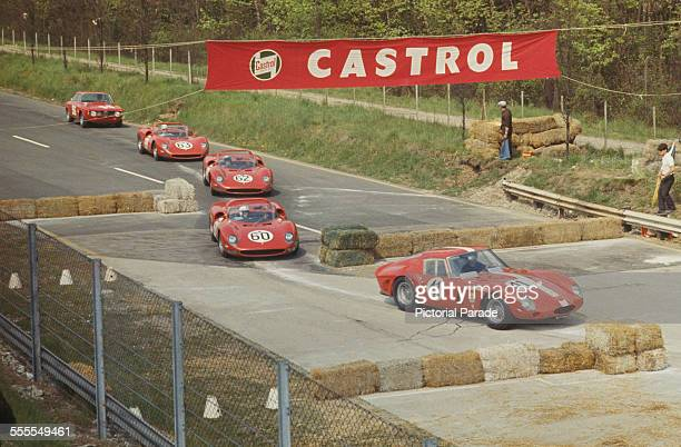 Ludovico Scarfiotti John Surtees Nino Vaccarella and Lorenzo Bandini enter the chicane during the 1000 Kilometres of Monza endurance race Autodromo...