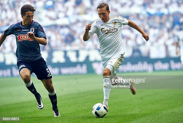 Ludvig Augustinsson of FC Copenhagen and Alexander Juel Andersen of AGF Aarhus compete for the ball during the Danish Alka Superliga match between FC...