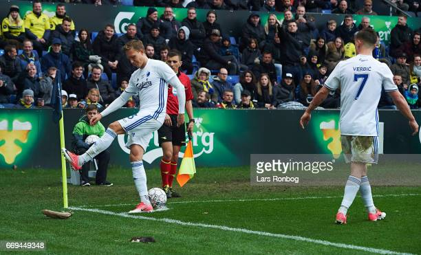 Ludvig Augustinsson of FC Copenhagen kicks to a rat thrown on to the pitch by fans of Brondby IF during the Danish Alka Superliga match between...
