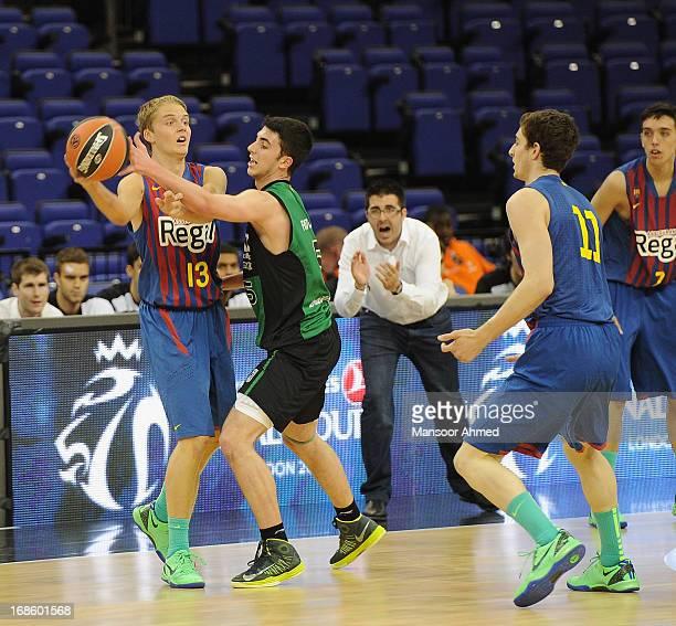 Ludvig Erik #13 of FC Barcelona Regal competes with Sergi Costa #5 of Club Joventut Badalona during the Nike International Junior Tournament Final...