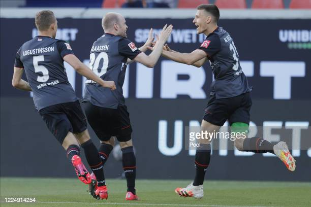 Ludwig Augustinsson, Davy Klaassen and Maximilian Eggestein of Bremen celebrate their team's 1-0 lead during the Bundesliga playoff second leg match...