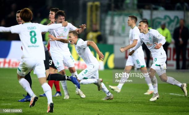 Ludwig Augustinsson of Bremen celebrate with his team mates after he scores the equalizing goal during the Bundesliga match between SportClub...