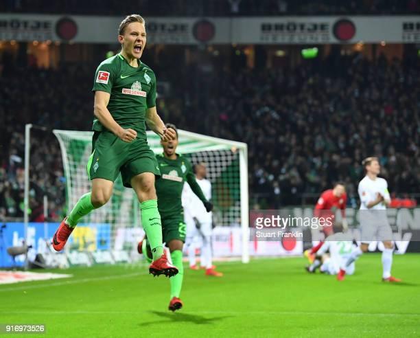 Ludwig Augustinsson of Bremen celebrates scoring his goal during the Bundesliga match between SV Werder Bremen and VfL Wolfsburg at Weserstadion on...