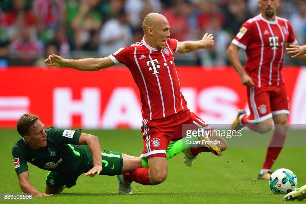 Ludwig Augustinsson of Bremen fights for the ball with Arjen Robben of Bayern Muenchen during the Bundesliga match between SV Werder Bremen and FC...