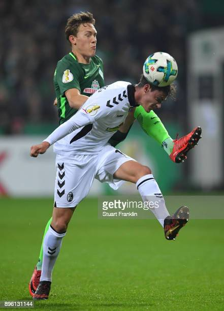 Ludwig Augustinsson of Bremen is challenged by Pascal Stenzel of Freiburg during the DFB Cup match between Werder Bremen and SC Freiburg at...