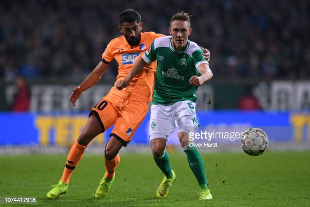Ludwig Augustinsson of SV Werder Bremen challenges for the ball with Kerem Demirbay of TSG 1899 Hoffenheim during the Bundesliga match between SV...