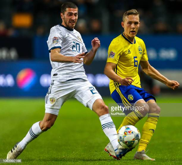 Ludwig Augustinsson of Sweden and Aleksei Ionov of the Russia vie for the ball during the UEFA Nations League B group two match between Sweden and...