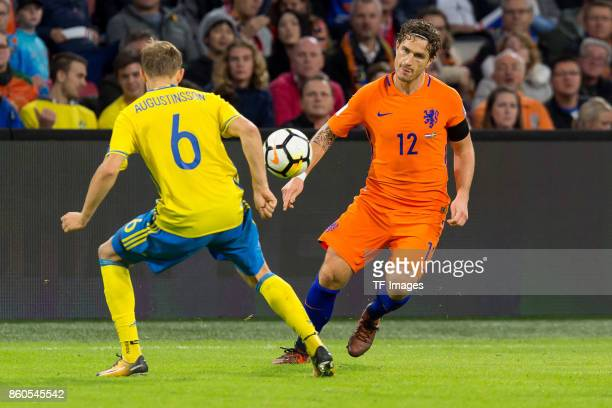 Ludwig Augustinsson of Sweden and Daryl Janmaat of Netherlands battle for the ball during the FIFA 2018 World Cup Qualifier between Netherlands and...