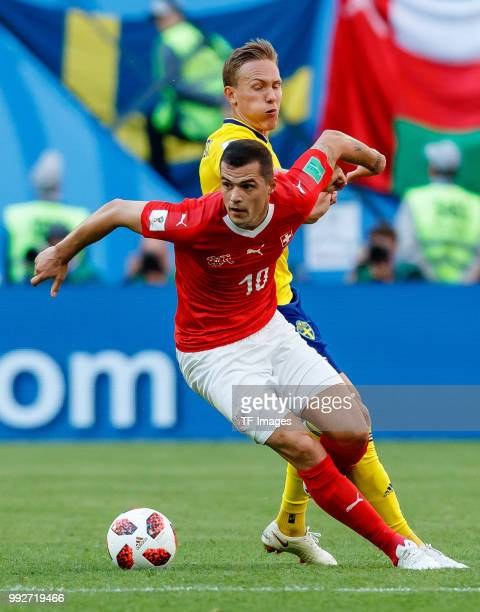 Ludwig Augustinsson of Sweden and Granit Xhaka of Switzerland battle for the ball during the 2018 FIFA World Cup Russia Round of 16 match between...