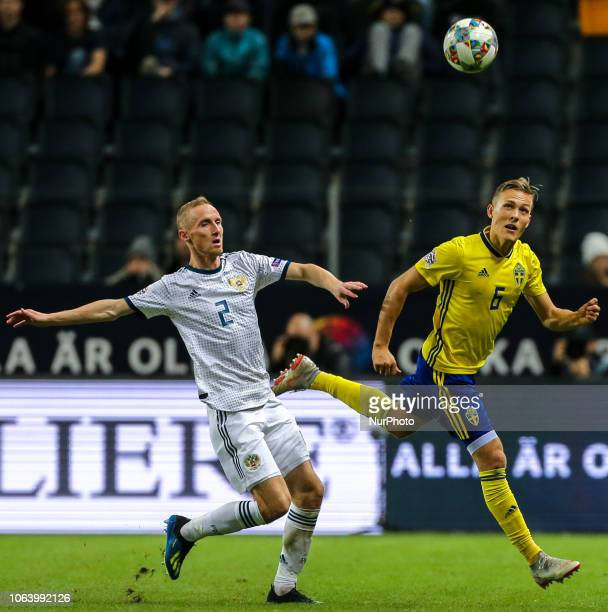 Ludwig Augustinsson of Sweden and Vladislav Ignatyev of the Russia vie for the ball during the UEFA Nations League B group two match between Sweden...
