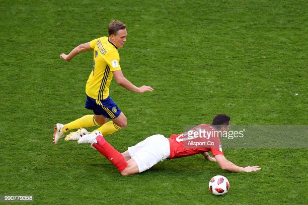 Ludwig Augustinsson of Sweden challenges Granit Xhaka of Switzerland during the 2018 FIFA World Cup Russia Round of 16 match between Sweden and...