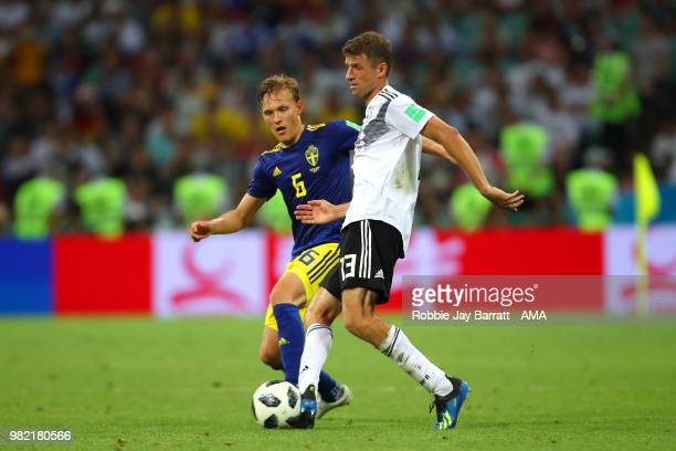 Ludwig Augustinsson of Sweden competes with Thomas Mueller of Germany during the 2018 FIFA World Cup Russia group F match between Germany and Sweden...