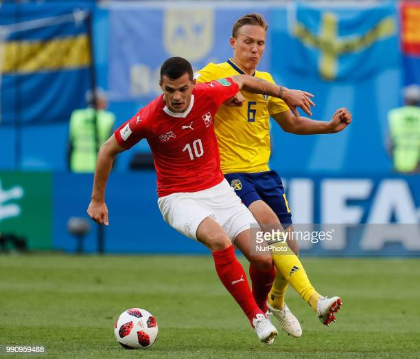 Ludwig Augustinsson of Sweden national team and Granit Xhaka of Switzerland national team vie for the ball during the 2018 FIFA World Cup Russia...