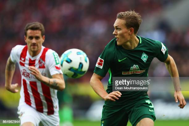 Ludwig Augustinsson of Werder Bremen battles for the ball with Simon Zoller of FC Koeln during the Bundesliga match between 1 FC Koeln and SV Werder...