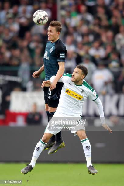 Ludwig Augustinsson of Werder Bremen challenges for the ball with Fabian Johnson of Borussia Monchengladbach during the Bundesliga match between...