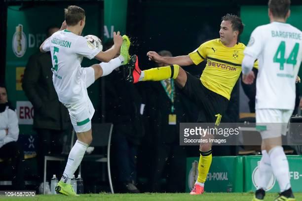 Ludwig Augustinsson of Werder Bremen Mario Gotze of Borussia Dortmund during the German DFB Pokal match between Borussia Dortmund v Werder Bremen at...