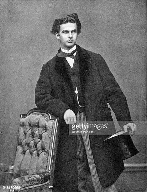 Ludwig II of Bavaria *2508184513061886 King of Bavaria leaning on a chair holding a top hat 1867 Photographer Josef Albert Vintage property of...