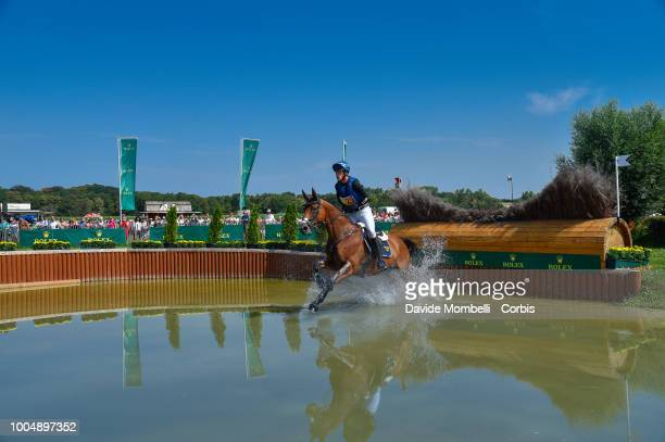 Ludwig Svennerstal of Sweden riding Stinger during the obstacle in the water of the Cross Country test DHLPrize in the park of the CHIO of Aachen on...