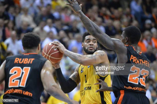 Ludwigsburg's DJ Kennedy in action against Ulm's Augustine Rubit  and Casey Prater during the German Bundesliga playoffs quarter final basketball...