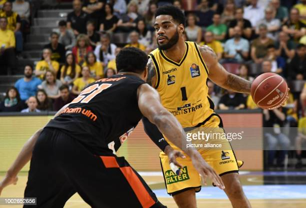 Ludwigsburg's DJ Kennedy in action against Ulm's Augustine Rubit during the German Bundesliga playoffs quarter final basketball match between MHP...