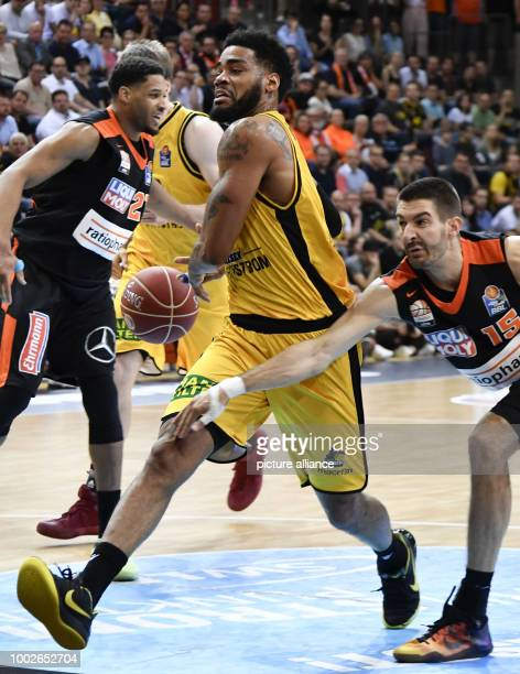 Ludwigsburg's DJ Kennedy in action against Ulm's Braydon Hobbs during the German Bundesliga playoffs quarter final basketball match between MHP...