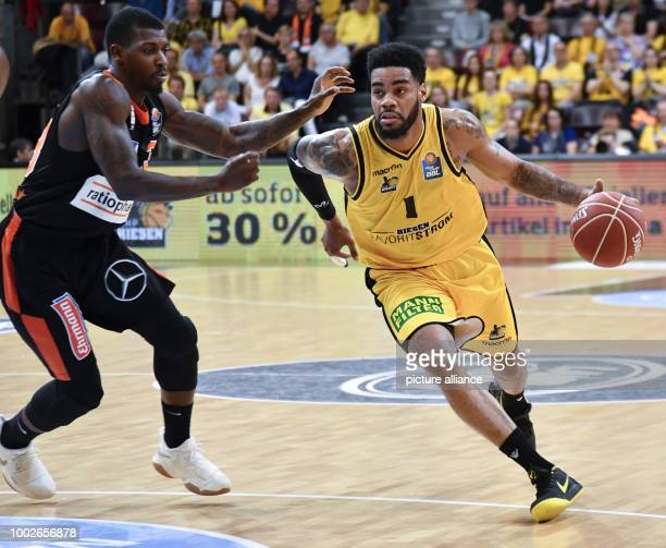 Ludwigsburg's DJ Kennedy in action against Ulm's Casey Prater during the German Bundesliga playoffs quarter final basketball match between MHP Riesen...
