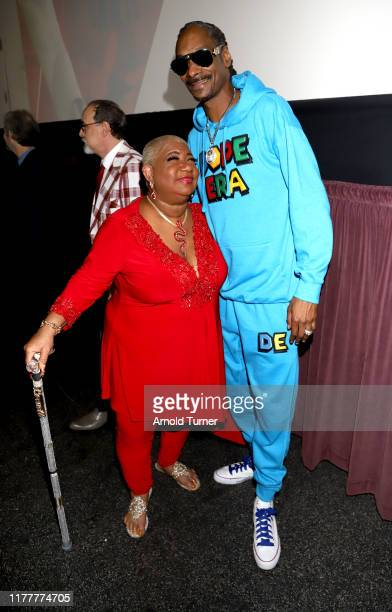 Luenell and Snoop Dogg attends the Dolemite Is My Name premiere presented by Netflix on September 28 2019 in Los Angeles California