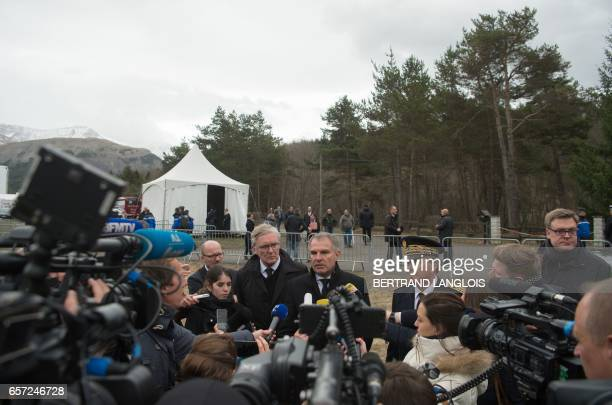 Luftansa CEO Carsten Spohr and Germanwings former CEO Thomas Winkelmann speak to journalists during the commemoration ceremonies at the Vernet...