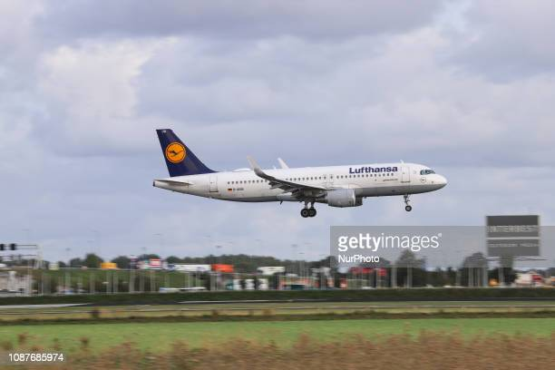 Lufthansa Airbus A320200 with registration DAIUN landing at Amsterdam Schiphol Airport AMS EHAM in the Netherlands Lufthansa with the Lufthansa Group...