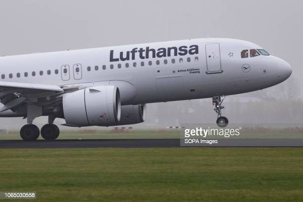 Lufthansa Airbus A320-271N or Airbus A320neo with registration D-AINM landing at Amsterdam Schiphol Airport in the haze. Lufthansa is the first...