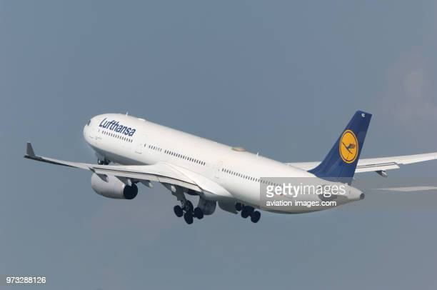 Lufthansa Airbus A330300 climbiong out after takeoff with undercarriage retracting