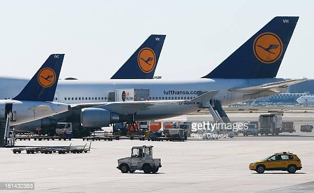 Lufthansa airplanes sit on the tarmac at the Frankfurt RheinMain Airport on September 7 2012 in Frankfurt Germany Lufthansa has canceled hundreds of...