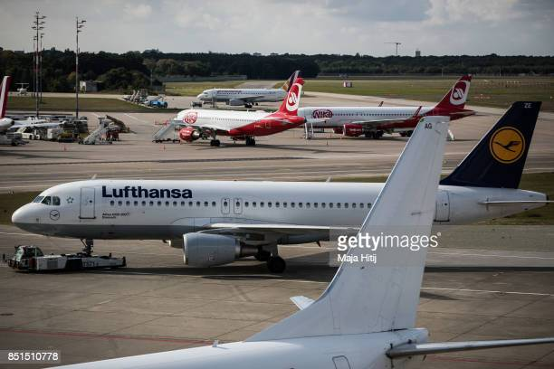 Lufthansa and Air Berlin planes are seen at Tegel Airport on September 22 2017 in Berlin Germany The city of Berlin is to hold a referendum this...